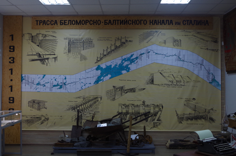 The museum's map of the White Sea-Baltic Canal (named after Stalin), with tools used by the prisoners to dig out the canal. (Mia Bennett)