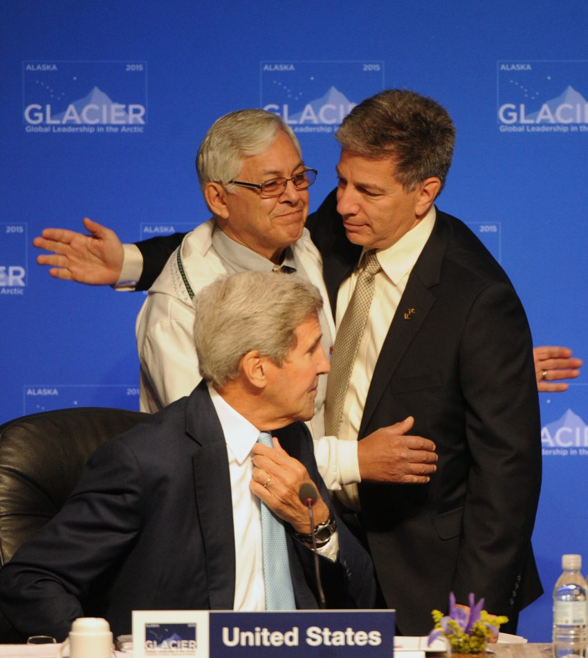 Northwest Arctic Borough Mayor Reggie Joule embraces Anchorage Mayor near Secretary of State John F. Kerry during the Global Leadership in the Arctic: Cooperation, Innovation, Engagement, and Resilience (GLACIER) Conference Opening Plenary at the Dena'ina Center in Anchorage on Monday, Aug. 31, 2015. (Bill Roth / Alaska Dispatch News)
