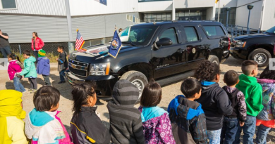 Kindergartners from June Nelson Elementary School in Kotzebue, Alaska get a tour of a presidential limousine outside their school on Tuesday, September 1, 2015. U.S. President Barack Obama will speak at the high school in Kotzebue on Wednesday. (Loren Holmes / Alaska Dispatch News)