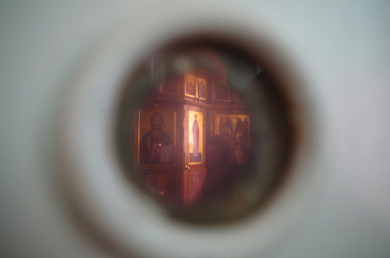 In the Russian Orthodox church on top of Sekirnaya Hill, the only trace of the gulag that once stood there is an unlabeled swinging door that still bears the peephole from its previous incarnation as a prison door. (Mia Bennett)