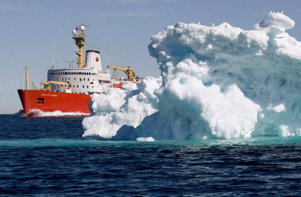 The Canadian Coast Guard icebreaker Louis S. St-Laurent sails past a iceberg in Lancaster Sound, Friday, July 11, 2008.An international body is poised to enact new rules to ensure cleaner shipping through fragile Arctic seas. (Jonathan Hayward/The Canadian Press)