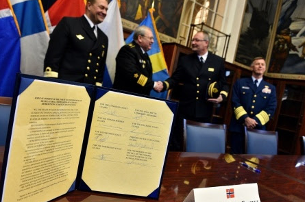 The Joint Statement officially establishing the Arctic Coast Guard Forum is displayed after being signed at the Coast Guard Academy in New London, Conn., Oct. 30, 2015. (Petty Officer 2nd Class Patrick Kelley/U.S. Coast Guard)
