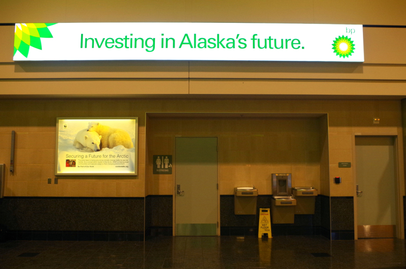 I wonder who paid more? Shell and the World Wildlife Foundation's competing signs at Ted Stevens International Airport in Anchorage, Alaska. (Mia Bennett)