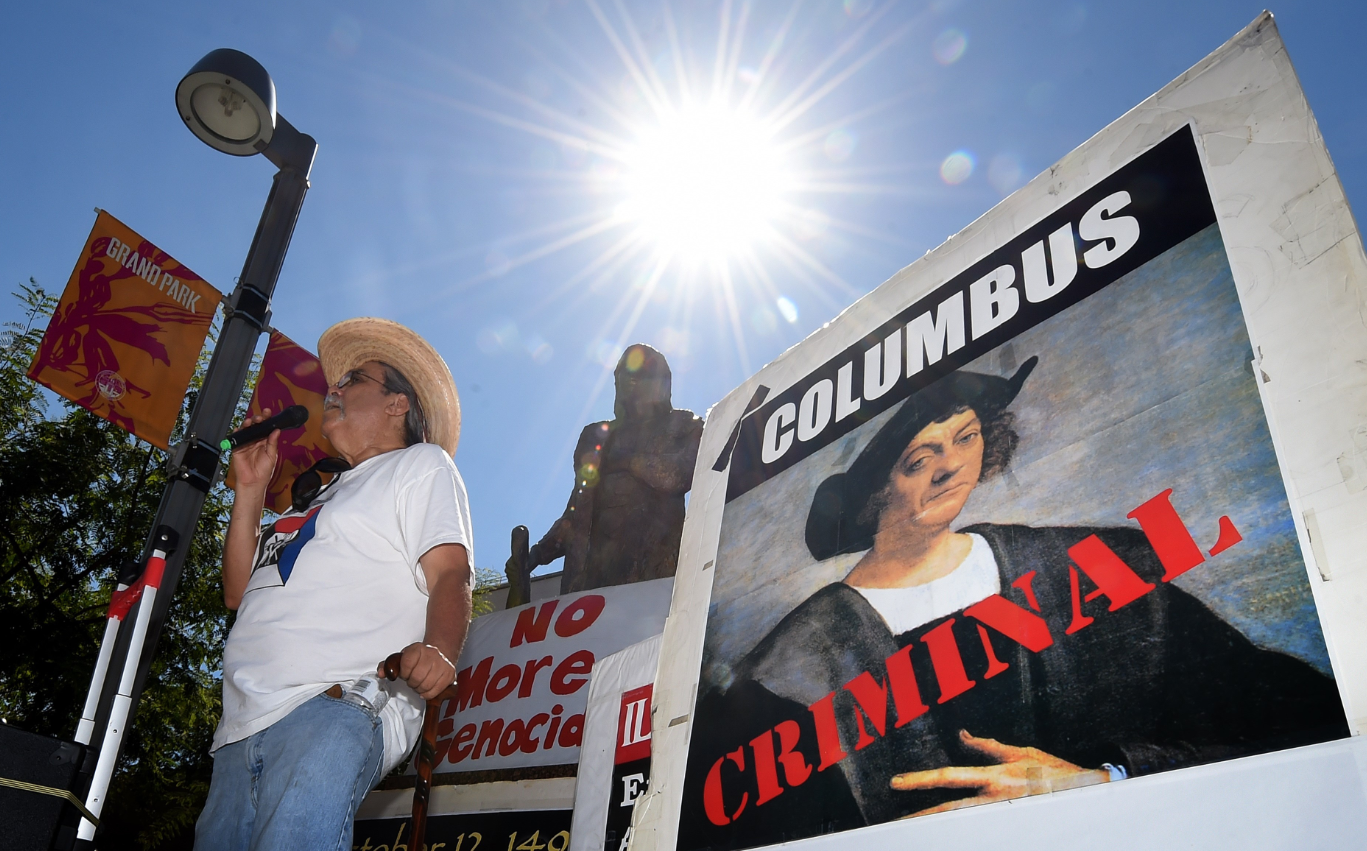 Olin Tezcatlipoca from the Mexica Movement speaks to demonstrators in front of a statue of Christopher Columbus during a protest against Columbus Day in Grand Park, Los Angeles, California on October 11, 2015. (Mark Ralston /AFP/Getty Images)