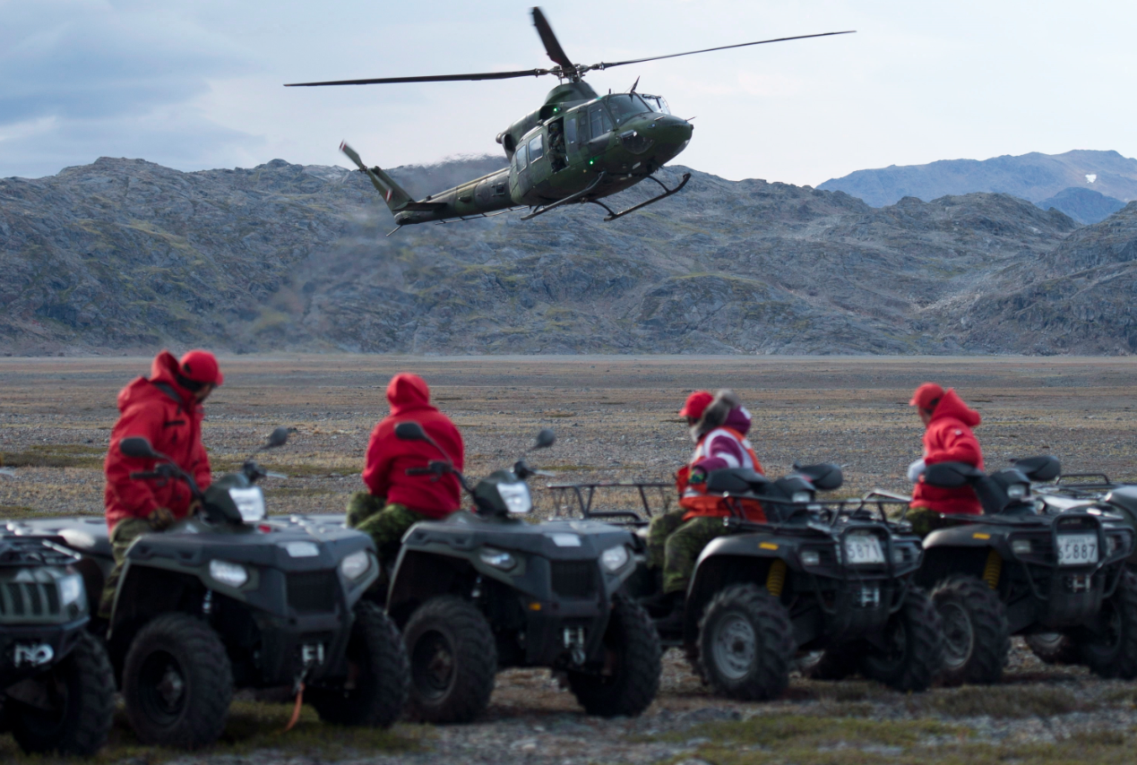 Canadian Rangers watch a Gryffon helicopter land near York Sound, Nunavut in August, 2014. (Adrian Wyld/The Canadian Press)