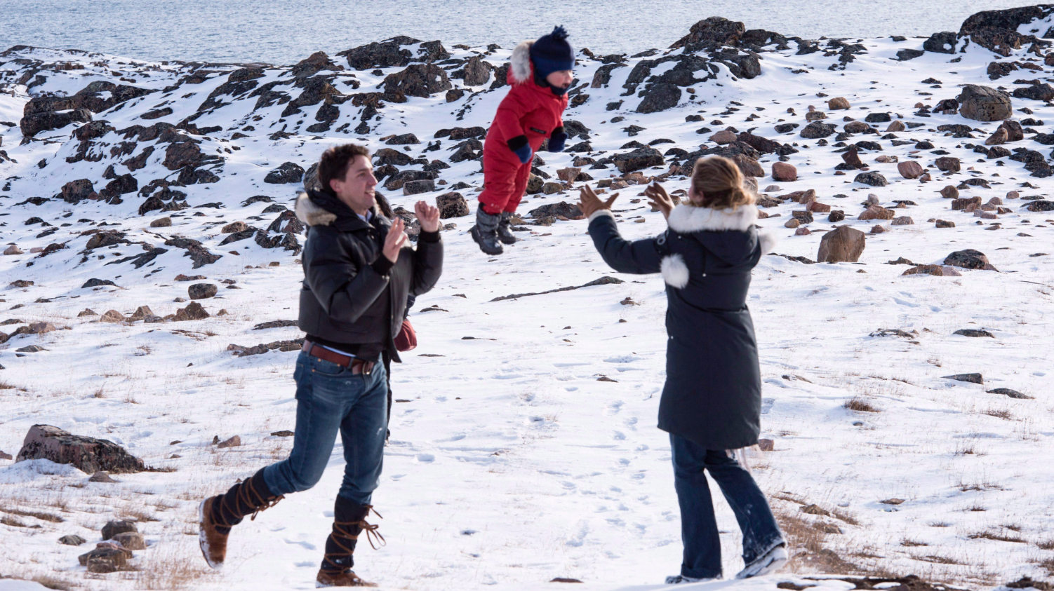 Prime Minister-designate Justin Trudeau and his wife Sophie Gregoire-Trudeau with thier youngest son Hadrien in the Arctic Canadian city of Iqaluit on October 10, 2015. (Paul Chiasson/The Canadian Press)