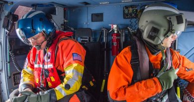 Aviation Survival Technician Micah Franklin, left, and Aviation Maintenance Technician Kyle Stalter are part of a crew of four aboard a Coast Guard Jayhawk helicopter during a flight flight near Prudhoe Bay on October 10. (Asaf Shalev / Alaska Dispatch News)