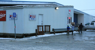 The state Alcoholic Beverage Control Board on Thursday approved a liquor store at this AC Quickstop, where the storage units now are housed. Alaska Commercial Co. will need two to four months or longer to ready the space for a store, an executive said Thursday. (Lisa Demer/Alaska Dispatch News)