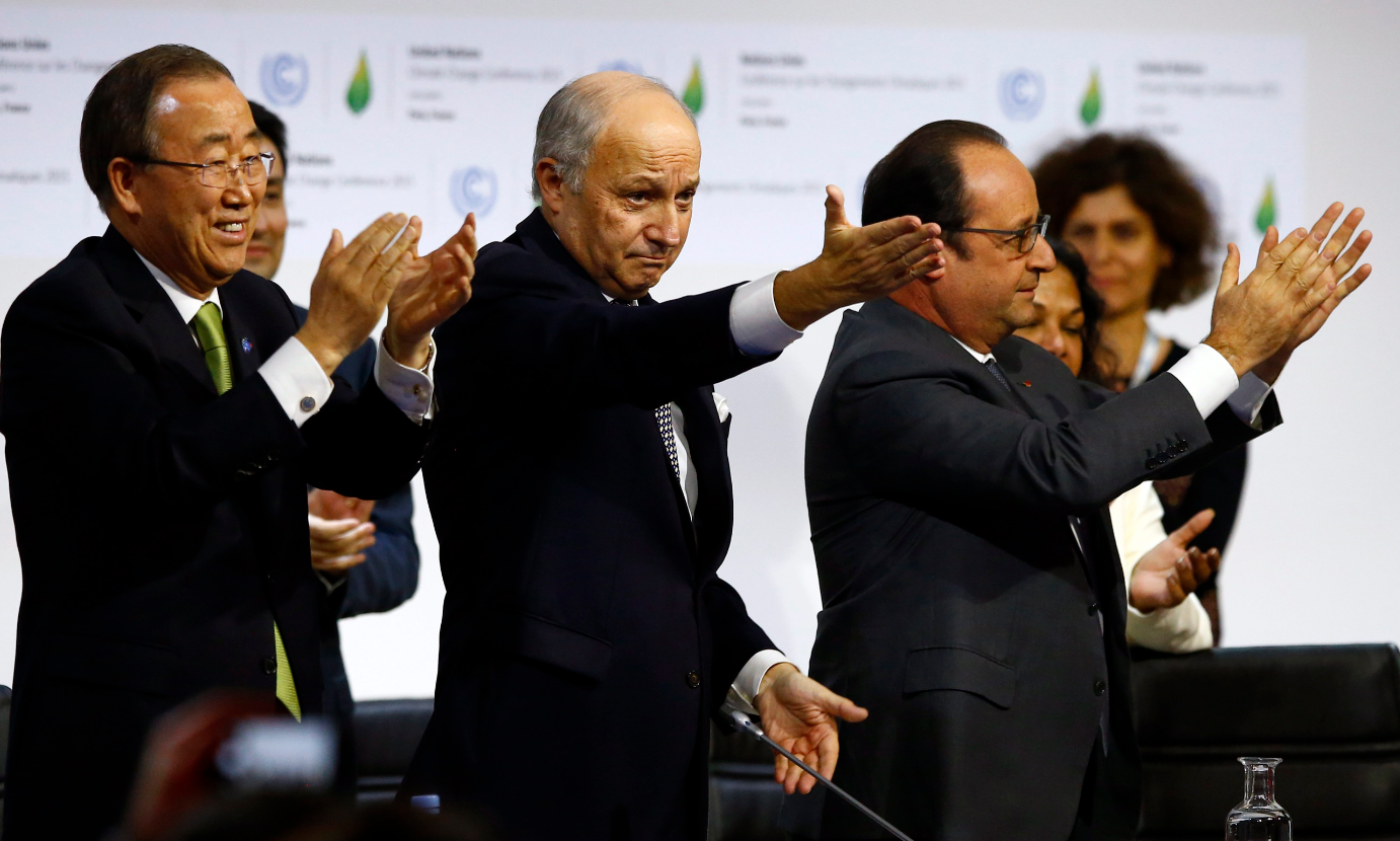 French President Francois Hollande, right, French Foreign Minister and president of the COP21 Laurent Fabius, center, and United Nations Secretary General Ban ki-Moon applaud after the final conference at the COP21, the United Nations conference on climate change, in Le Bourget, north of Paris, Saturday, Dec.12, 2015. Governments have adopted a global agreement that for the first time asks all countries to reduce or rein in their greenhouse gas emissions. (Francois Mori/AP)