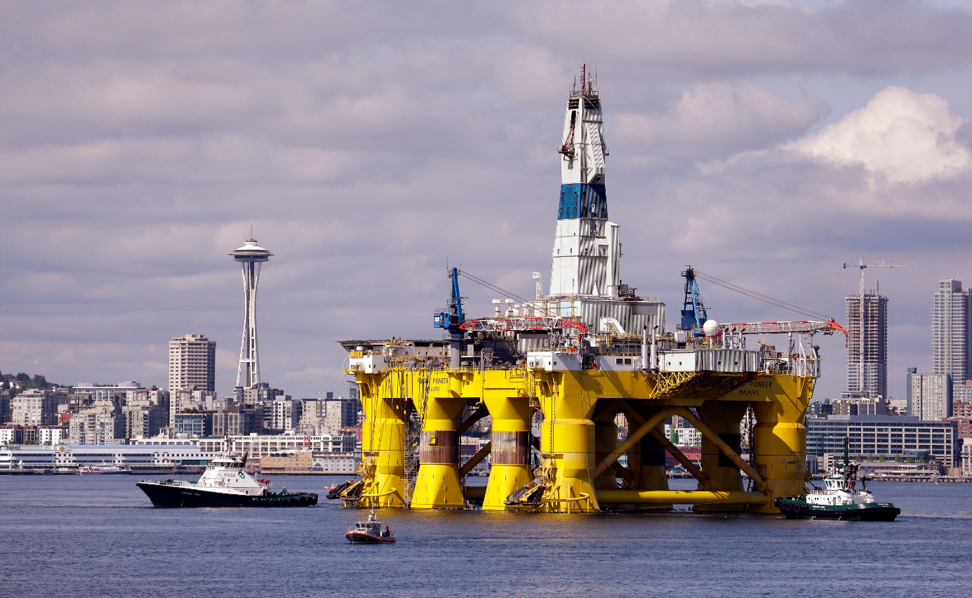 The oil drilling rig Polar Pioneer in a dock in Seattle in May 2015. The rig was one of two drilling rigs Royal Dutch Shell had planned to use for Arctic oil exploration. (Elaine Thompson/File/AP)