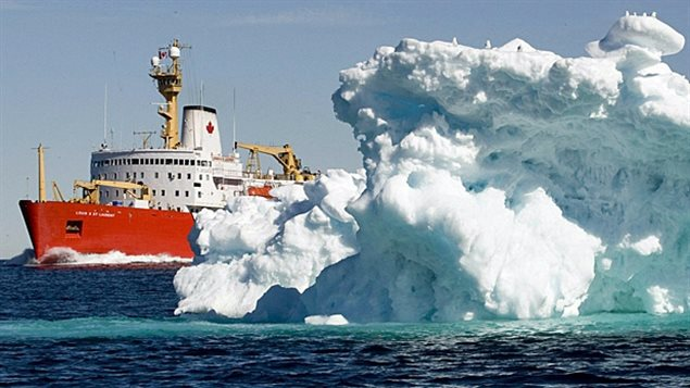 The Canadian Coast Guard icebreaker Louis St. Laurent sails past a iceberg in Lancaster Sound in July 2008. (Jonathan Hayward/The Canadian Press)