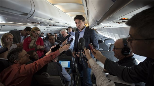 Canada's Prime Minister Justin Trudeau speaks to reporters while flying from Antalya, Turkey to Manila, Philippines on Tuesday, Nov. 17, 2015, to attend the APEC Summit. (Sean Kilpatrick/The Canadian Press)