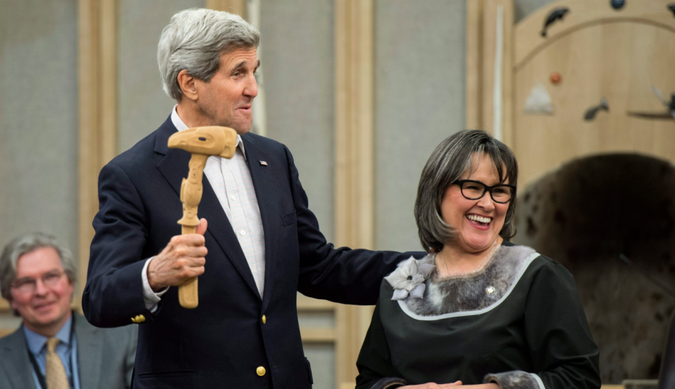U.S. Secretary of State John Kerry receives the Arctic Council gavel from Leona Aglukkaq, then Canada's Minister for the Arctic Council, in Iqaluit, Nunavut on April 24, 2015. (Paul Chiasson/The Canadian Press)