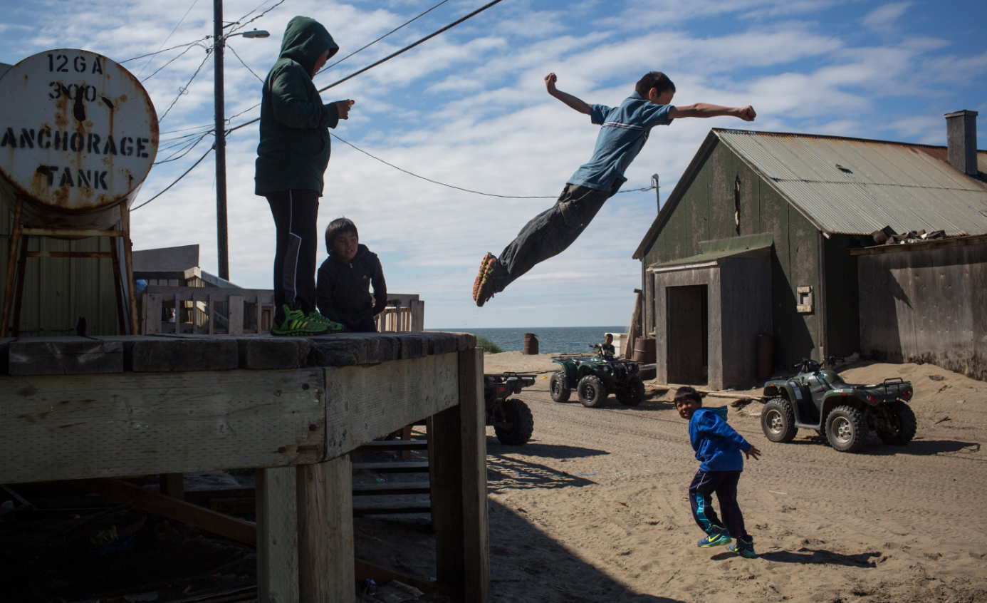 Village children jump off of a loading dock on July 8, 2015 in Shishmaref, Alaska. Earlier this year the Obama administration approved Shell Oil to begin drilling for oil in Arctic regions, including the Chukchi sea, worrying locals who live in the region and disappointing conservationists. (Andrew Burton/Getty Images)