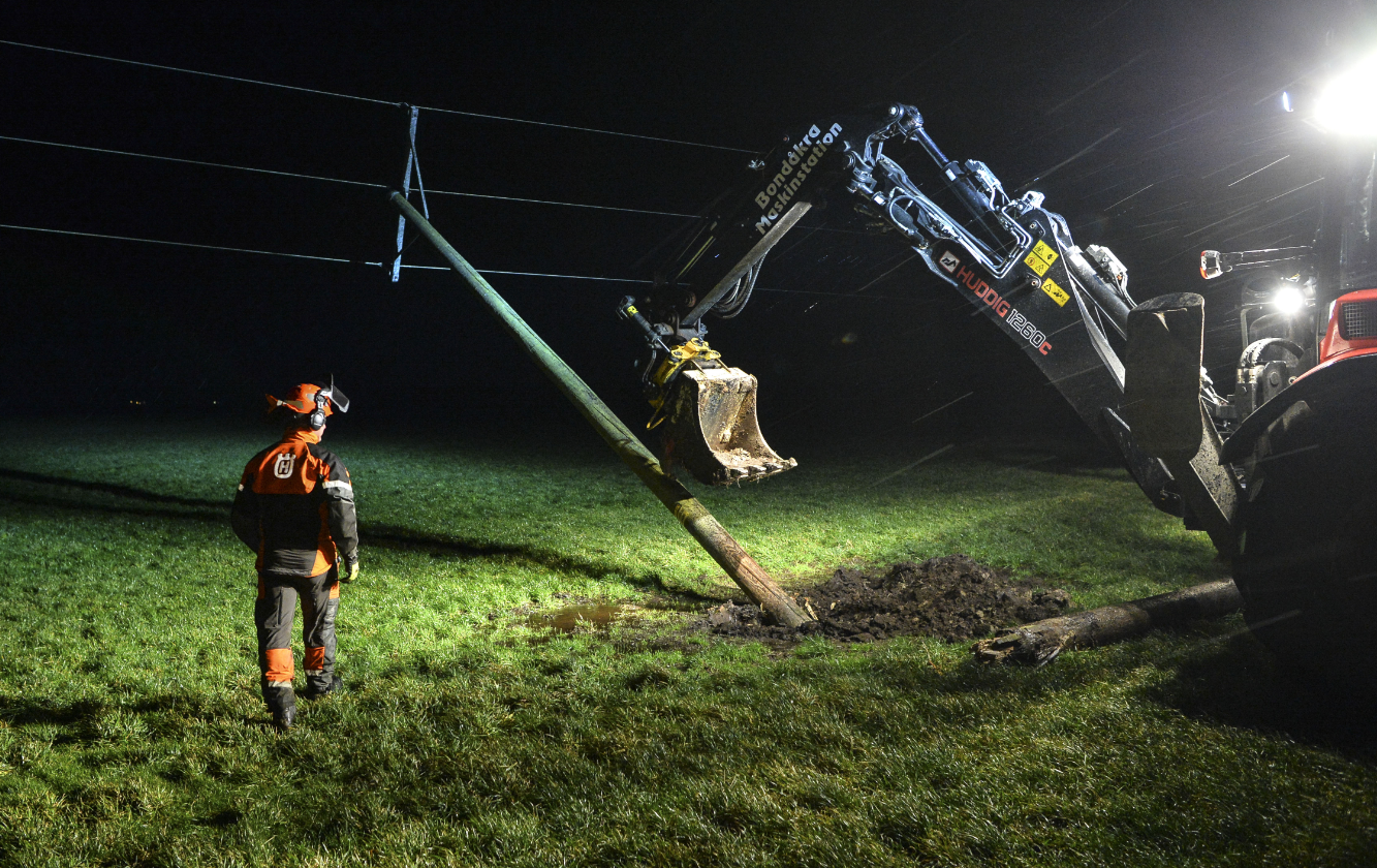 A worker stands next to a damaged power line in Laholm, southern Sweden on November 30, 2015 after storm 'Gorm.' (Johan Nilsson/TT/AFP/Getty Images)