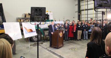 Gov. Bill Walker presented his budget plan in an event at the Lynden Hangar on Dec. 9, 2015. (Rachel Waldholz/APRN-Anchorage)