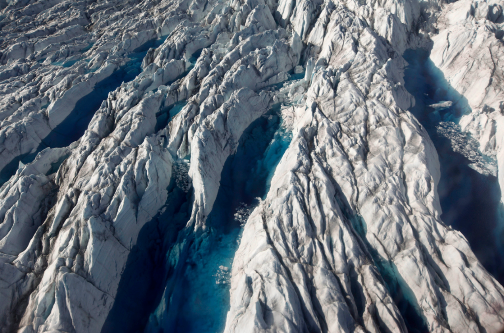 Pools of melted ice form atop Jakobshavn Glacier, near the edge of the Greenland ice sheet in 2011. (Brennan Linsley/AP)