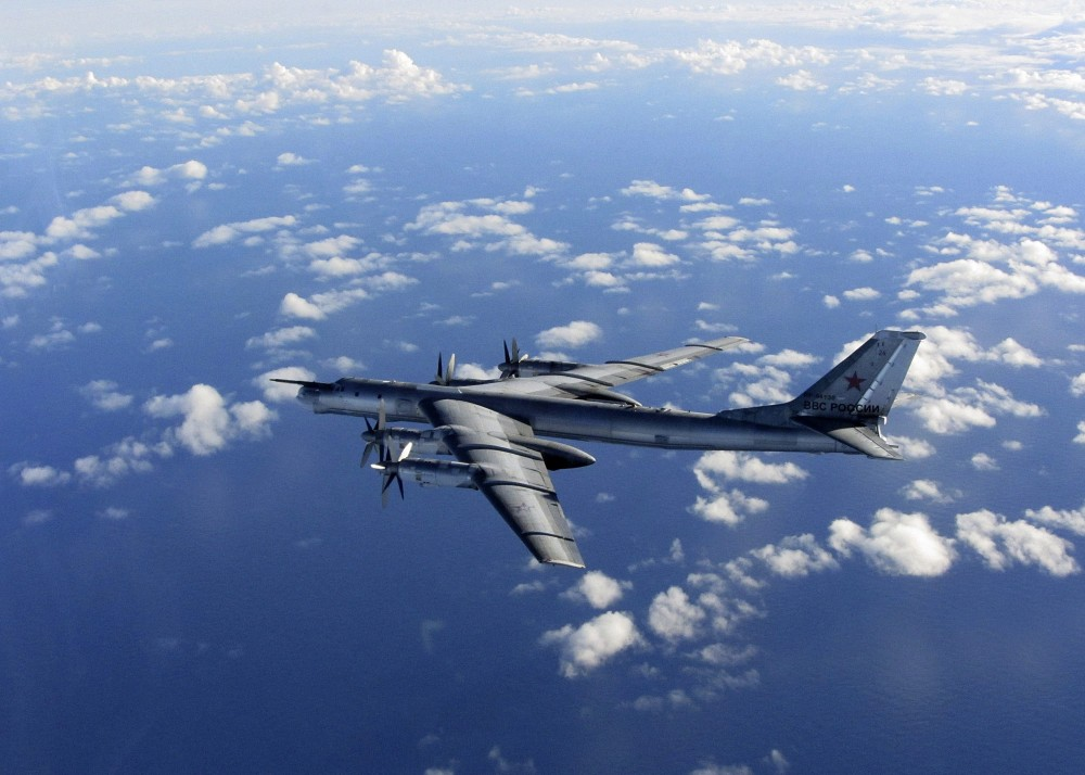 This is a Wednesday, Oct. 29, 2014 file photo provided by Britain's Royal Air Force of a Russian military long range bomber aircraft photographed by an intercepting RAF quick reaction Typhoon as it flies in international airspace. (AP Photo/Royal AIr Force)