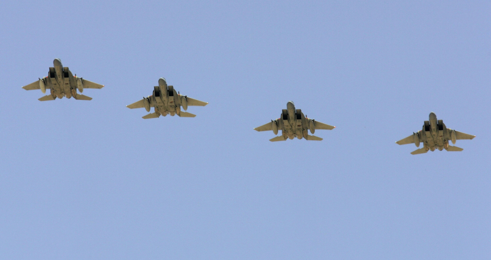 Four U.S. Air Force F-15 aircraft fly over Nellis Air Force Base  in Las Vegas, Nevada in 2006. (Ethan Miller/Getty Images)