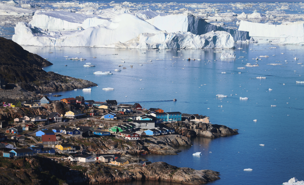 The village of Ilulissat is seen near the icebergs that broke off from the Jakobshavn Glacier on July 24, 2013 in Ilulissat, Greenland. (Joe Raedle/Getty Images)