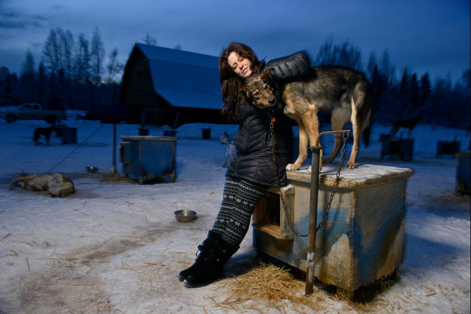 Iditarod veteran Karin Hendrickson, shown here with her dog Whack-A-Mole, plans to race in the 2016 Iditarod. Hendrickson, of Willow, was seriously injured when a vehicle struck her four-wheeler while she was training her dog team in 2014. Marc Lester / ADN