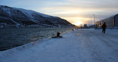 The sun goes down on the port in Tromso, Norway in 2016. (Eilís Quinn/Eye on the Arctic)