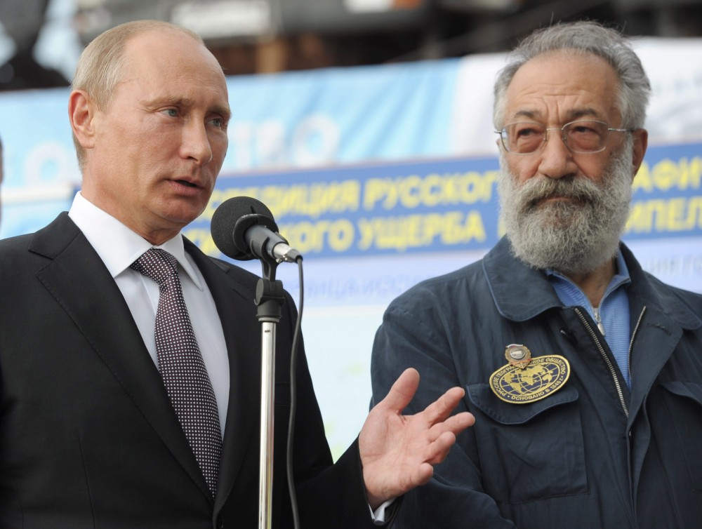 "Russian President Vladimir Putin, left, speaks as Polar explorer and lawmaker Artur Chilingarov listens to him during a ceremony to launch the construction of Russia's fourth Borei-class (Project 955A) ballistic missile submarine ""Knyaz Vladimir,"" or Prince Vladimir, at Sevmash, Russia's largest shipyard and sole nuclear submarine plant located in the city of Severodvinsk on the White Sea in Monday, July 30, 2012. (AP Photo/RIA-Novosti, Alexei Nikolsky, Presidential Press Service)"