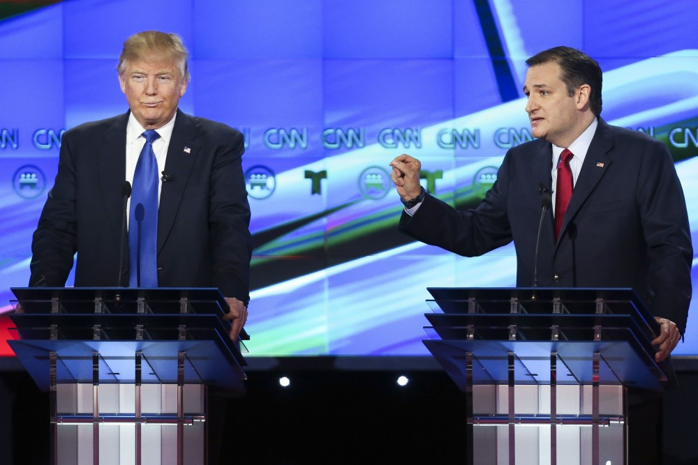 Republican presidential candidate, Donald Trump, left, listens as Republican presidential candidate, Sen. Ted Cruz, R-Texas, answers a question during the Republican Presidential Primary Debate at the University of Houston Thursday, Feb. 25, 2016, in Houston. Gary Coronado/AP Photo/Houston Chronicle, Pool