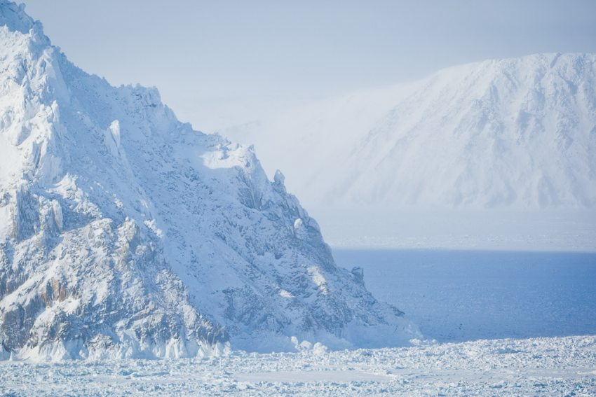 In this March 14, 2012 file photo, Little Diomede island, foreground, and its Russian counterpart, Big Diomede, are separated by only 2.4 miles. Despite tense U.S.-Russia relationships elsewhere, the two nations have been able to continue to cooperate in the Arctic. (Loren Holmes/Alaska Dispatch News)