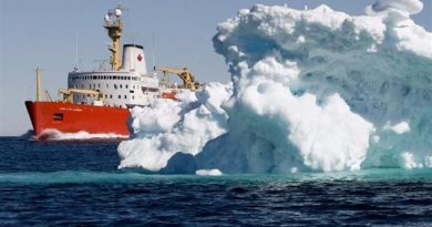 The Canadian Coast Guard icebreaker Louis S. St-Laurent sails past an iceberg in Lancaster Sound, Friday, July 11, 2008.   Jonathan Hayward/ The Canadian Press