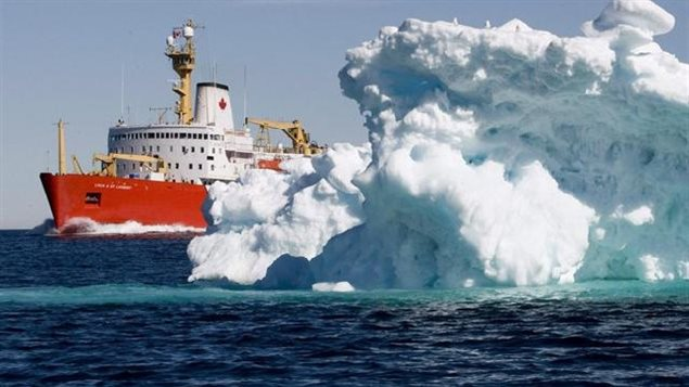 The Canadian Coast Guard icebreaker Louis S. St-Laurent sails past an iceberg in Lancaster Sound, Friday, July 11, 2008. Canada still has little capacity to respond to emergencies in the Arctic while risks increase from more shipping, development pressure, and sovereignty control concerns. ( Jonathan Hayward/ The Canadian Press)