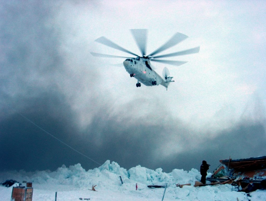 Russian Mi-26 helicopter lands on the iceberg where Severny Polyus-32 station was located with 12 Russian researchers huddled for three days in temperatures of minus 39 Celsius (minus 38 Fahrenheit) March 6, 2004. Helicopters plucked a team of scientists from deep within the Arctic Circle after their research station was crushed beneath a wall of ice. Vladimir Strugatskiy /REUTERS