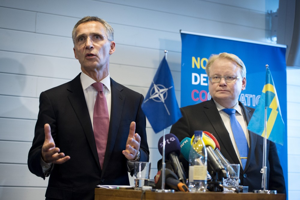 NATO Secretary General Jens Stoltenberg (L) and Sweden's Defence Minister Peter Hultqvist hold a news conference after a Nordic defence ministers meeting in Stockholm, Sweden, November 10, 2015. Jessica Gow/REUTERS/TT News Agency