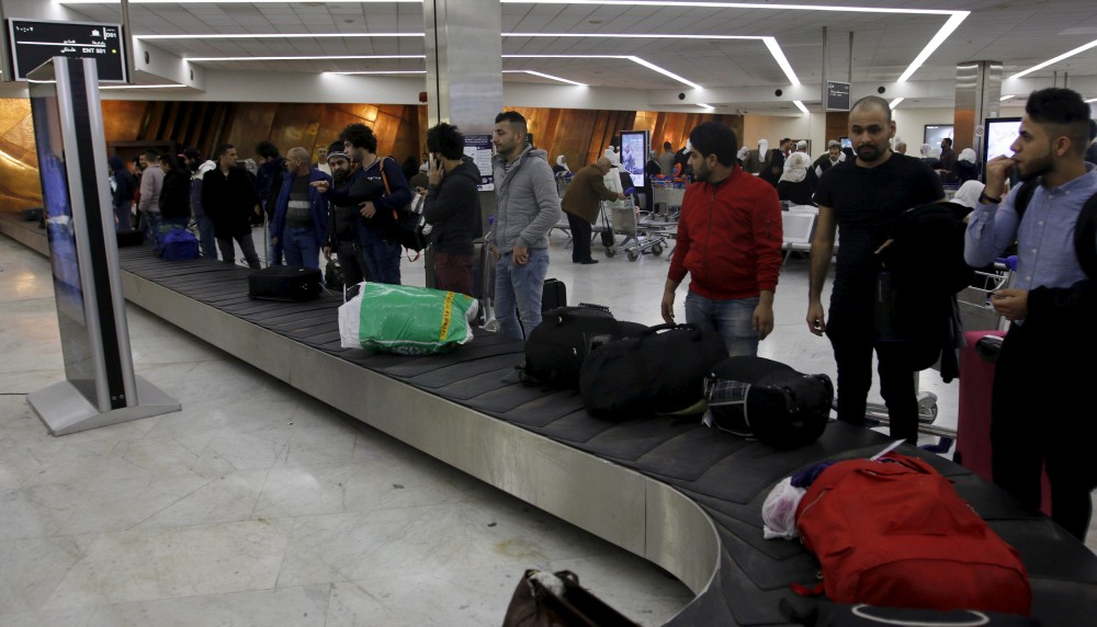Iraqi refugees returning from Finland wait for their luggage at Baghdad airport, Iraq February 18, 2016. Khalid al Mousily/REUTERS