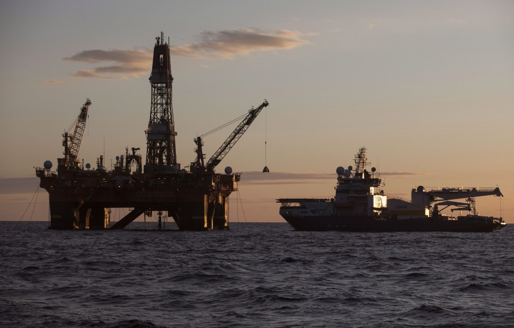In this photo provided by the Rosneft company, West Alfa drilling platform is seen anchored at the Cara Sea some 250 km (156 miles) north off Russian shore, on Thursday, Sept. 18, 2014. AP Photo/Rosneft press service