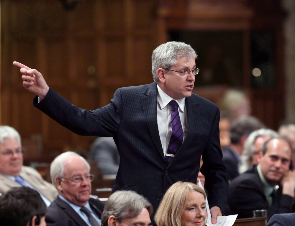NDP MP Charlie Angus stands in the House of Commons during question period on Parliament Hill in Ottawa on June 9, 2015. The Speaker of the House of Commons has agreed to hold an emergency debate on the suicide crisis in Attawapiskat First Nation. Fred Chartrand/THE CANADIAN PRESS