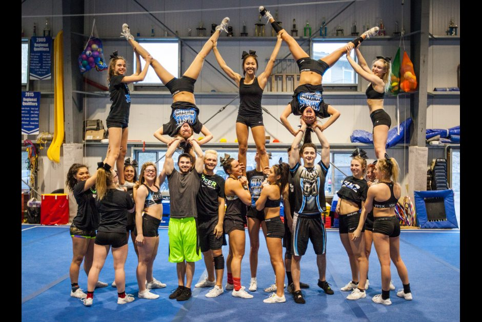 Alaska Athletics cheerleading all stars Black Ice strike a pose April 17, 2016, at Denali Gymnastics & Fitness in Wasilla. The Black Ice team is competing in the 2016 Cheerleading Worlds competition in Orlando, Florida, where their coach says they're favored to do well. Tara Young / ADN