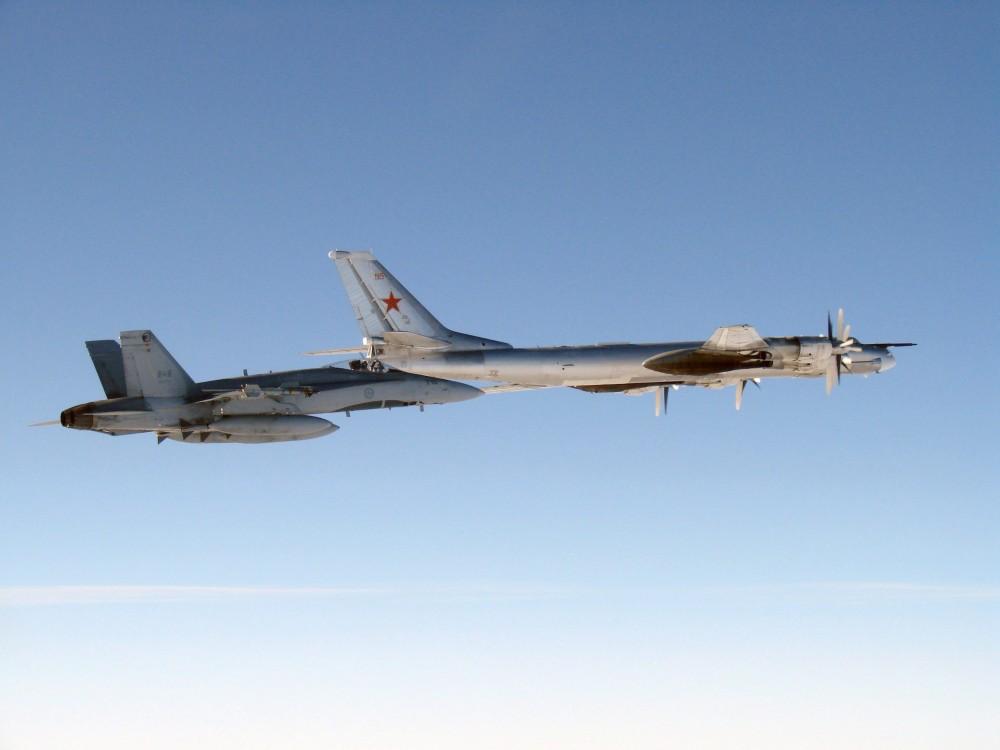 A CF-18 Hornet (left) from 4 Wing Cold Lake flies next to a Russian Tu-95 Bear bomber on Sept. 5, 2007. HO-Department of National Defence/THE CANADIAN PRESS