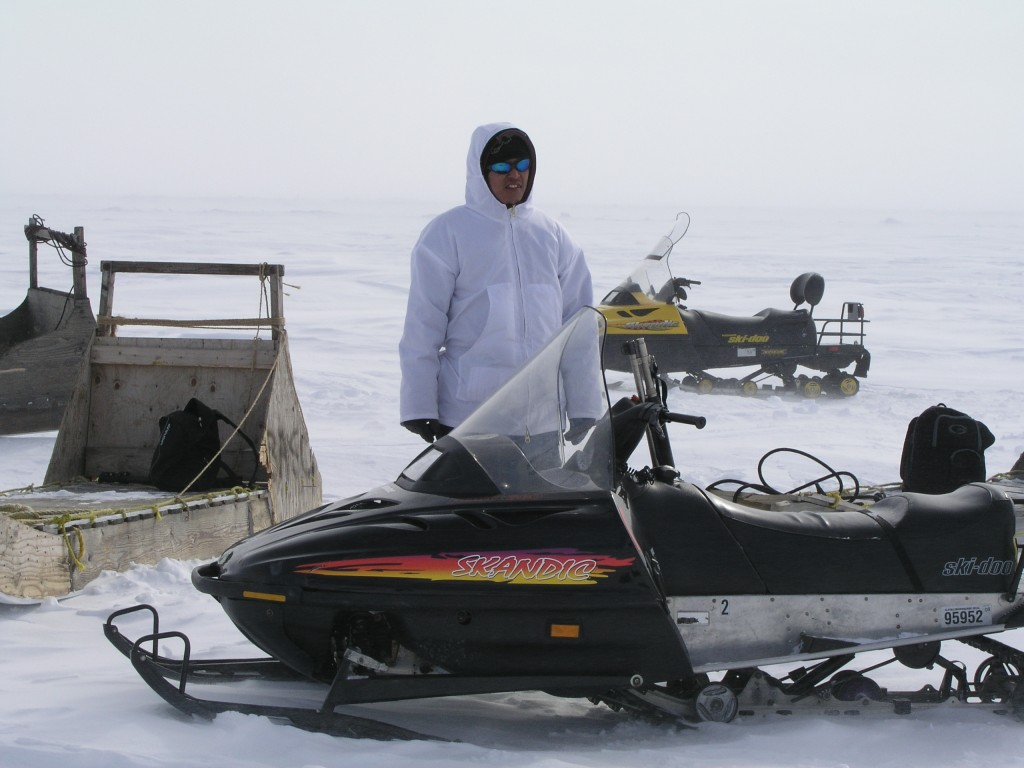 Remote Arctic communities rely on close cooperation. (First Nation guide standing bear guard for scientists). Photo Irene Quaile