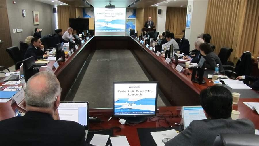 Participants listen to a presentation at the Korean Polar Research Institute's roundtable on an international fisheries accord. Henry Huntington/The Pew Charitable Trusts