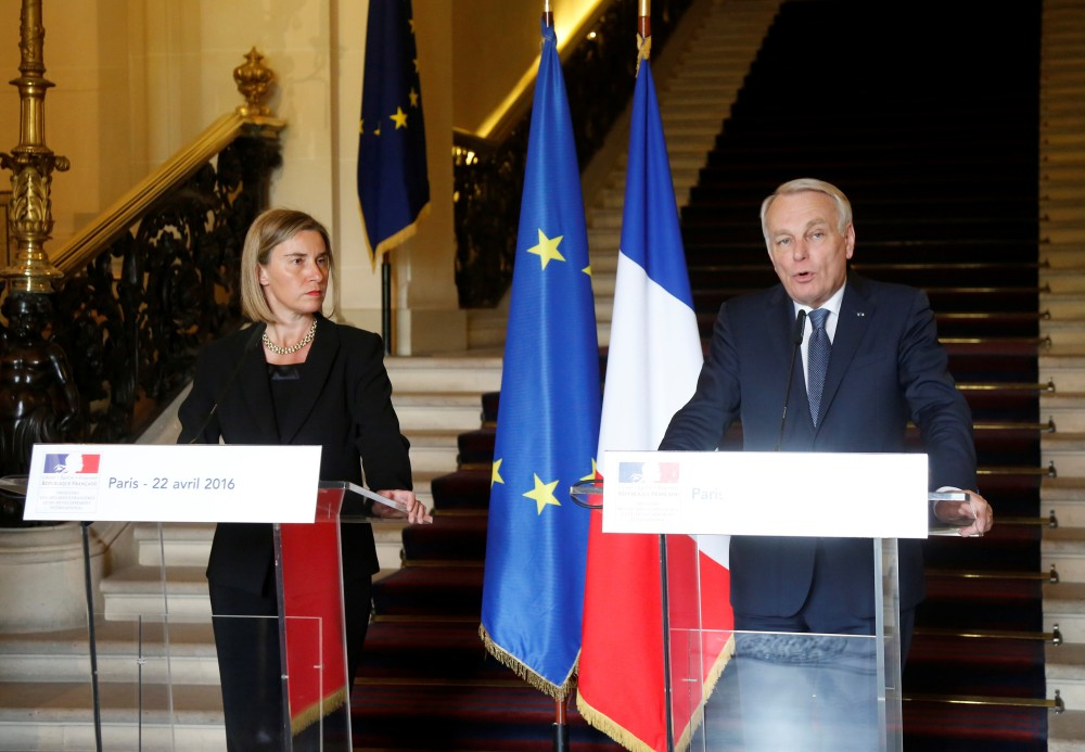 European Union foreign policy chief Federica Mogherini (L) and French Foreign Minister Jean-Marc Ayrault attend a news conference in Paris, France, April 22, 2016. Jacky Naegelen/REUTERS