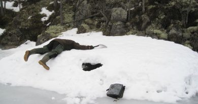 A researcher plunges into the entry to an abandoned Saimaa ringed seal nest. Photo: Miina Auttila/Metsähallitus