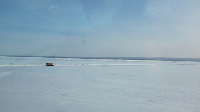A truck driving across the frozen Lena River from the village of Bestyakh. Photo by Mia Bennett
