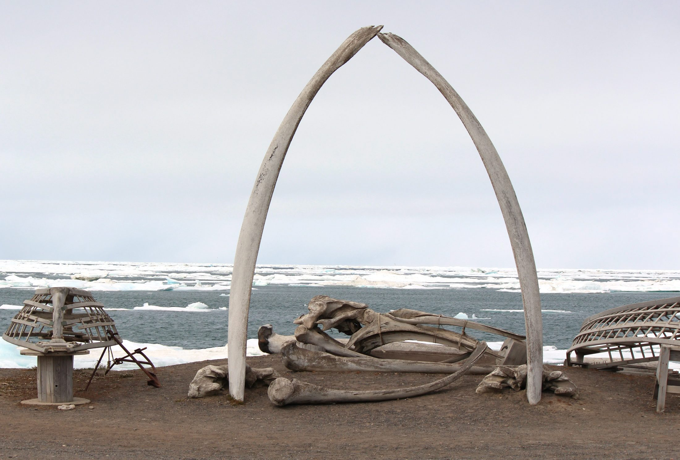 A whalebone arch sits on the Barrow, Alaska shoreline in this file photo as ice floats in the Arctic Ocean beyond. Arctic Alaskan cities like Barrow, Nome and Anchorage posted record-warm temperatures for the entire month of April. .(AP Photo/Kodiak Daily Mirror, Nicole Klauss)