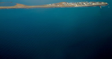 This aerial photo shows the island village of Kivalina, Alaska. What is the future of solar energy in communities like this one? (Andrew Harnik/AP/The Canadian Press)