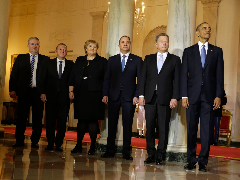 President Barack Obama, stands with, from left, Iceland's Prime Minister Sigurdur Ingi Johannsson, Denmark's Prime Minister Lars Lokke Rasmussen, Norwegian Prime Minister Erna Solberg, Sweden's Prime Minister Stefan Lofven and Finnish President Sauli Niinisto during the arrival ceremony for the Nordic summit, Friday, May 13, 2016, at the White House in Washington. (Carolyn Kaster/AP/CP)