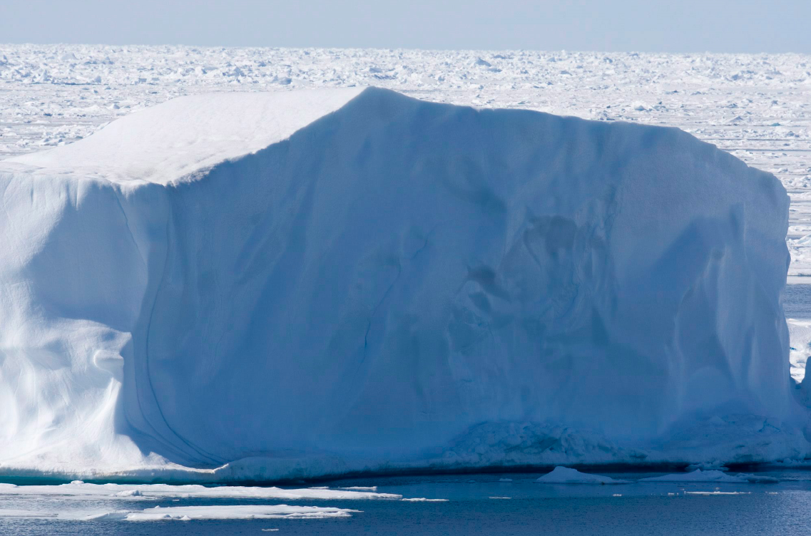 An iceberg floating in Canada's High Arctic. As climate change makes northern shipping routes more accessible, what impact will it have on Canada's trade relationships with Asia? (Jonathan Hayward/The Canadian Press)