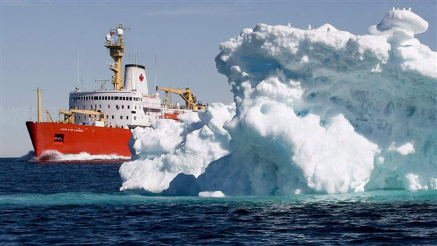 The Canadian Coast Guard icebreaker Louis S. St-Laurent sails past a iceberg in Lancaster Sound, Friday, July 11, 2008. (Jonathan Hayward/ The Canadian Press)
