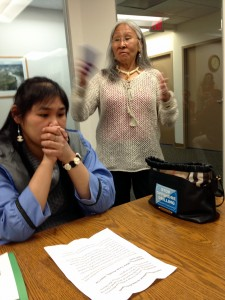 Point Lay tribal council member Cilia Attungowruk, left, and tribal President Marie Tracey met with reporters at the office of the Alaska Wilderness League. ( Liz Ruskin/APRN)