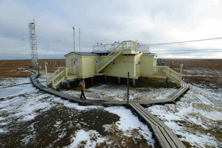 Technician Ross Burgener staffs the NOAA Global Monitoring Division Barrow Observatory on September 21, 2015, about 5 miles outside of town. Three vertical intakes behind the structure, back left, capture air samples for analysis. The site also hosts short-term research projects from around the world. (Erik Hill / Alaska Dispatch News)